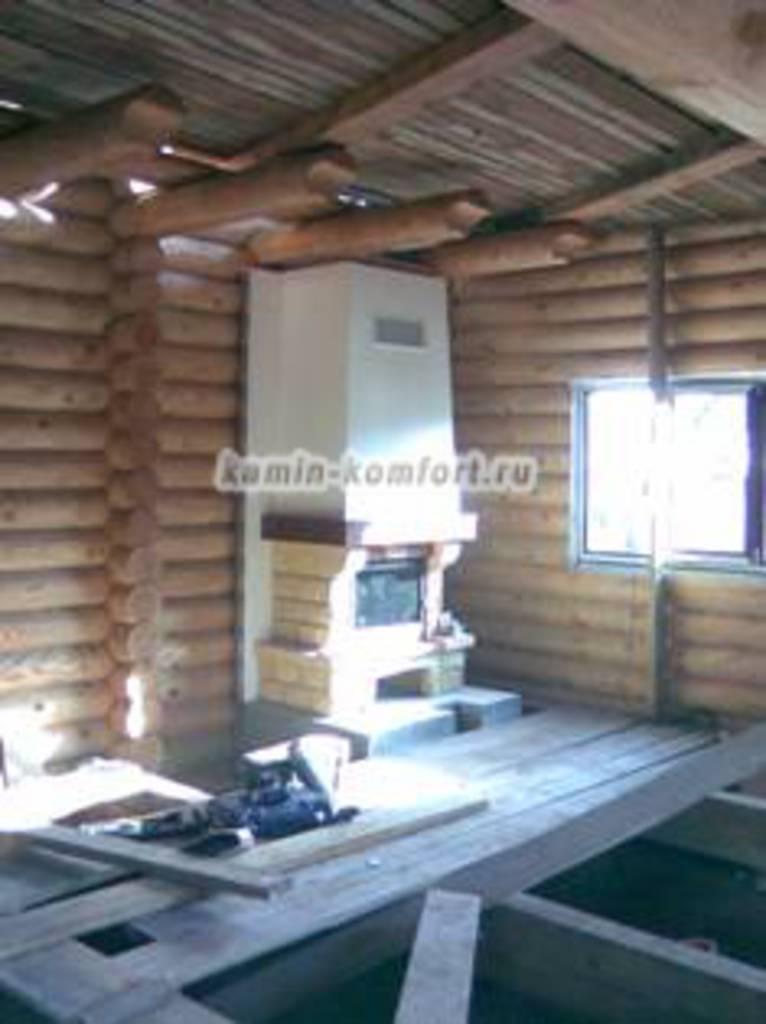 Фото Готовый камин в деревянном доме
